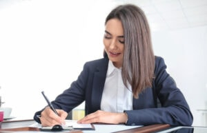 An attorney woman writing a business contract