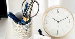 an image of a clock and a pencil holder with pens and pencils for coaches who want legal tips