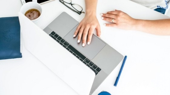 an image of a girl typing on a laptop and doing free seo keyword research